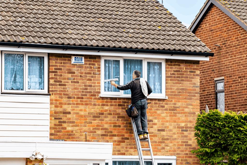 Window Cleaner on Ladder